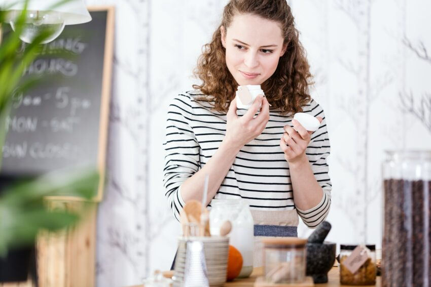 Woman smelling soaps